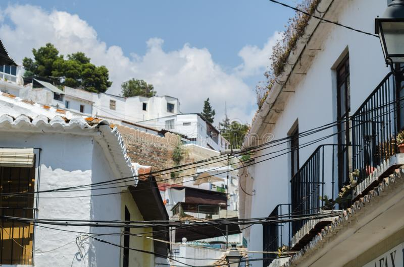 VELEZ-MALAGA, SPAIN - AUGUST 24, 2018 view of buildings in small. VELEZ-MALAGA, SPAIN - AUGUST 24, 2018 roofs and facades of buildings in a Spanish city royalty free stock photo