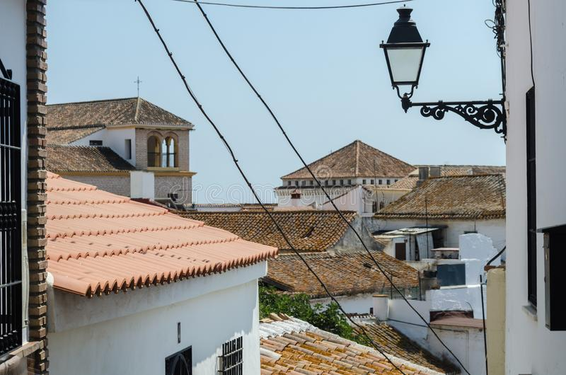 VELEZ-MALAGA, SPAIN - AUGUST 24, 2018 view of buildings in small. VELEZ-MALAGA, SPAIN - AUGUST 24, 2018 roofs and facades of buildings in a Spanish city royalty free stock photos