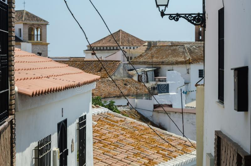 VELEZ-MALAGA, SPAIN - AUGUST 24, 2018 view of buildings in small. VELEZ-MALAGA, SPAIN - AUGUST 24, 2018 roofs and facades of buildings in a Spanish city royalty free stock photography
