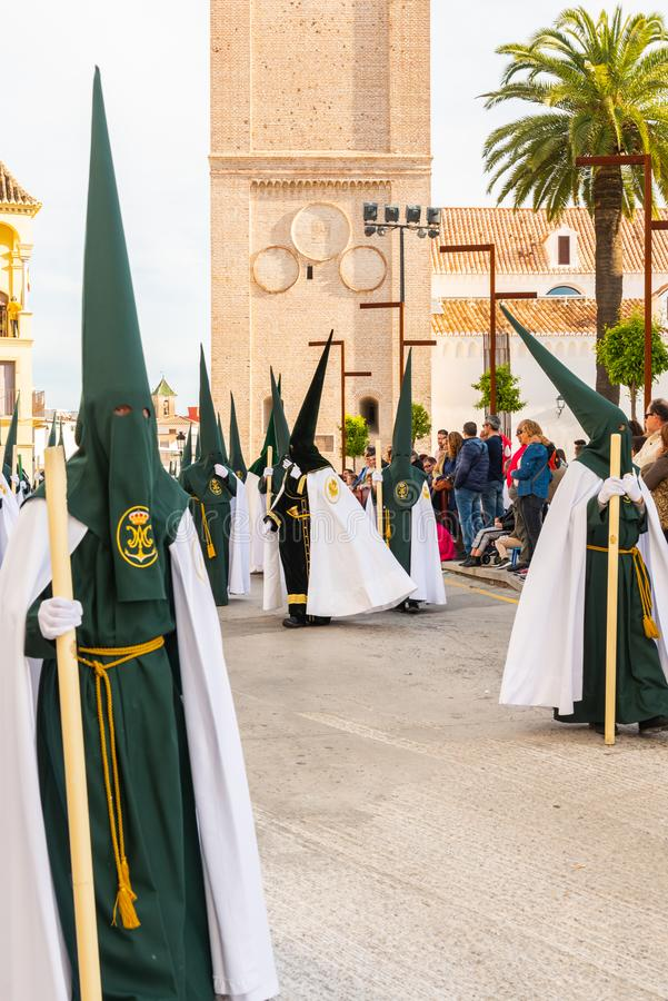 VELEZ-MALAGA, SPAIN - MARCH 29, 2018 People participating in the procession  in the Holy Week in a Spanish city stock images
