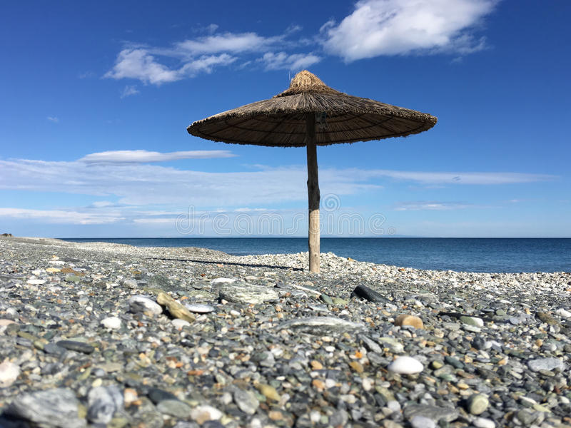 Velika beach. With a parasol in Greece royalty free stock images