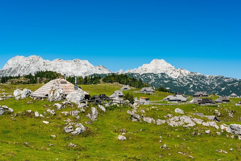 Velika Planina or Big Pasture Plateau in Slovenia. Traditional Alpine Wooden Village and Pasture. Agriculture, alps, architecture, balkan, beautiful, blue stock image