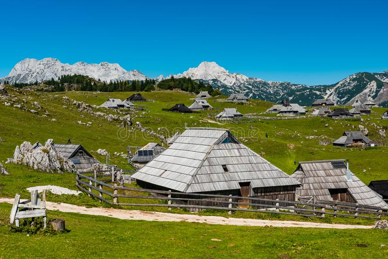 Velika Planina or Big Pasture Plateau in Slovenia. Traditional Alpine Wooden Village and Pasture. Agriculture, alps, architecture, balkan, beautiful, blue stock images