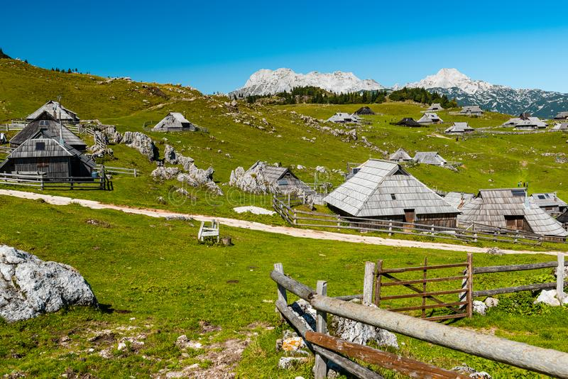 Velika Planina or Big Pasture Plateau in Slovenia. Traditional Alpine Wooden Village and Pasture. Agriculture, alps, architecture, balkan, beautiful, blue stock photography