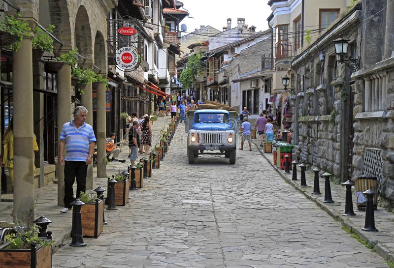 People are walking by the narrow street in Veliko Tarnovo royalty free stock photos