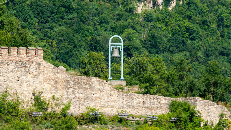 Veliko Tarnovo. The old bell on the wall of the fortress royalty free stock image
