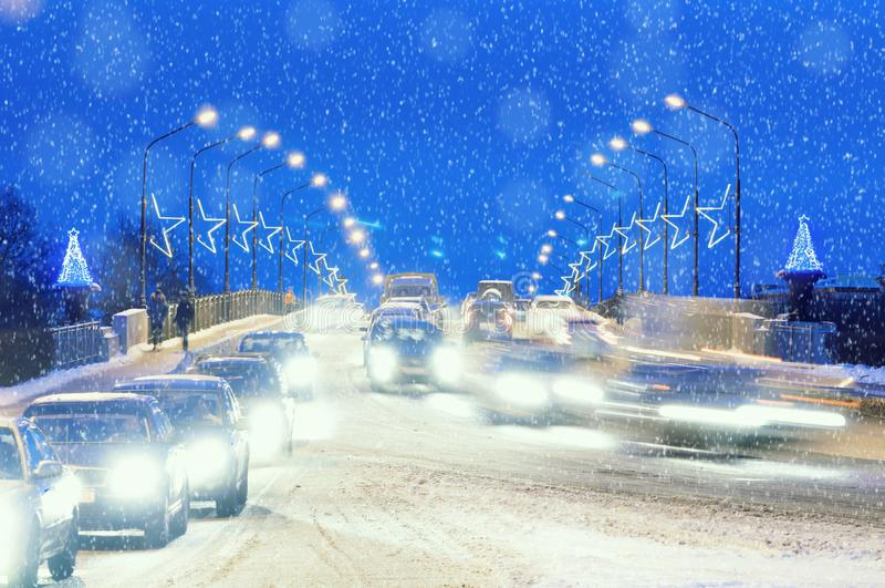 Veliky Novgorod, Russia. Alexander Nevsky road bridge in Veliky Novgorod, Russia and New year illumination, winter night view royalty free stock photos
