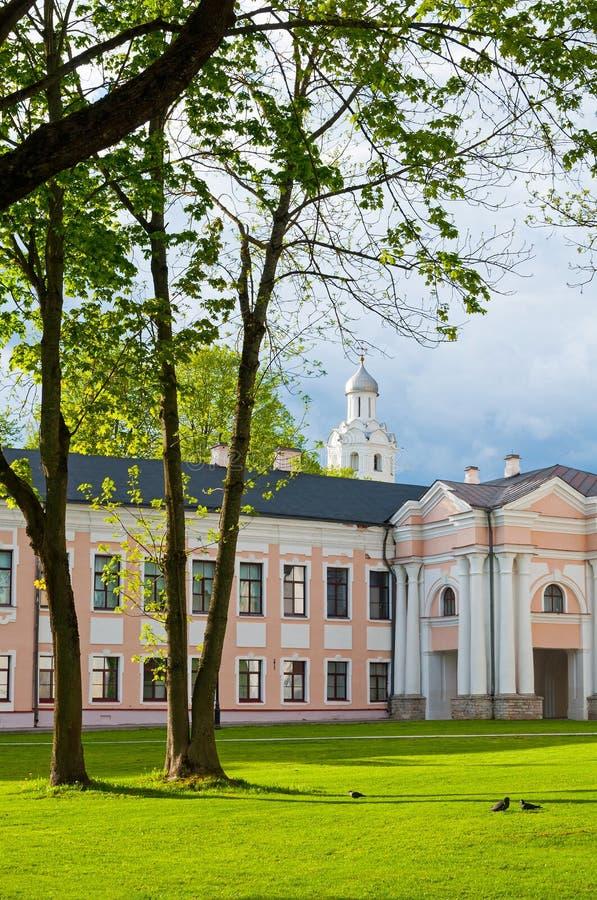 Veliky Novgorod, Russia. Architectural spring landscape - Novgorod Kremlin park with Clock Tower framed by trees. In Veliky Novgorod, Russia stock photo