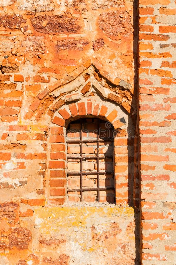 Veliky Novgorod, Russia. Closeup of red brick wall and window of St John the Merciful Church at Myachino royalty free stock photography