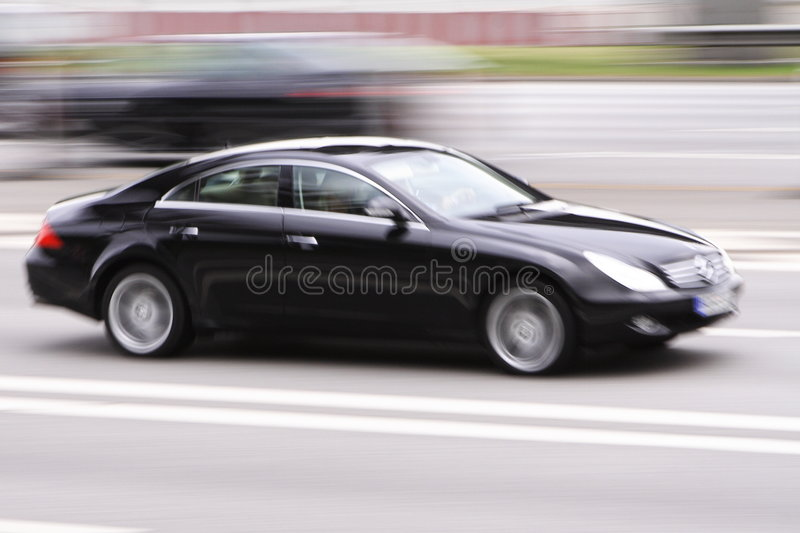 Velocidad de lujo del coche imagenes de archivo