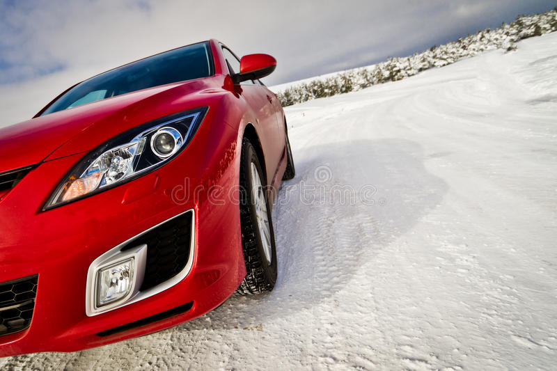 Velocity red car. On a snowy road. Ai-Petry, Crimea stock image
