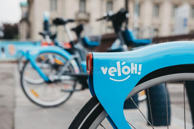 Veloh electric pedal-assisted rental bikes on a street in Luxembourg City royalty free stock photo