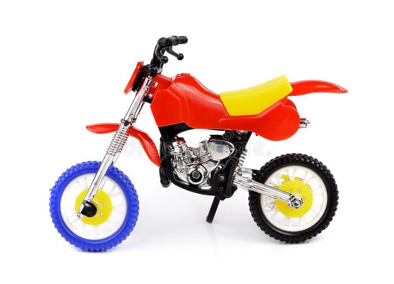 Velomotor do brinquedo no fundo branco imagem de stock royalty free