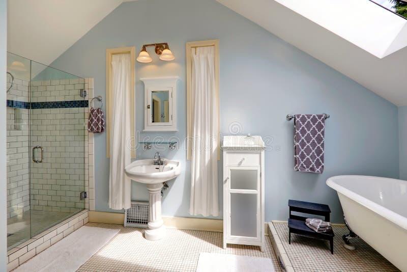 Velux bathroom with antique bath tub royalty free stock photo