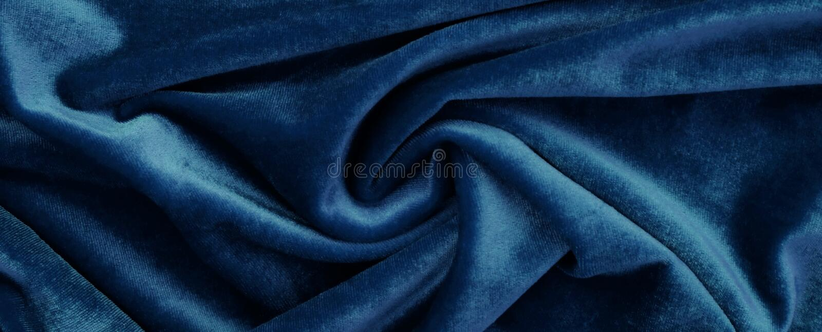 Velvet background, texture, blue color, expensive luxury, fabric, royalty free stock image