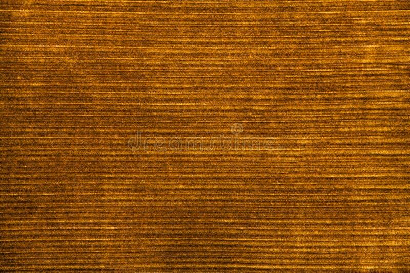 Velvet fabric yellow brown. Vintage retro background royalty free stock photo