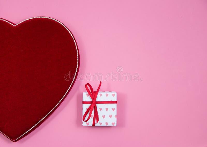 Velvet heart and wrapped gift stock photos