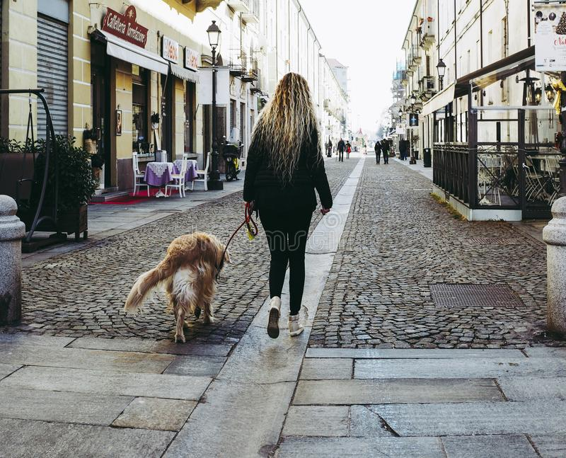Woman with dog in Venaria stock image