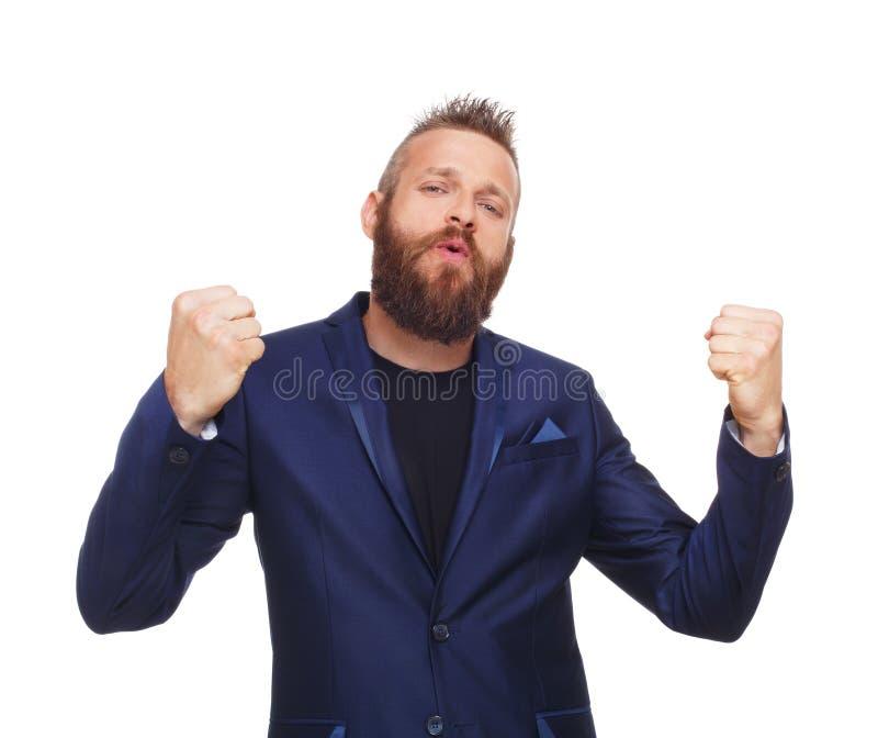 Vencedor afortunado Homem farpado no terno feliz do sucesso imagens de stock royalty free