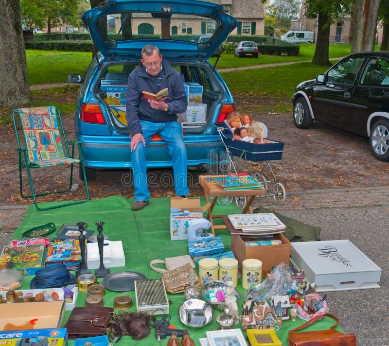 Venda do carregador do carro em uma vila holandesa pequena imagem de stock royalty free