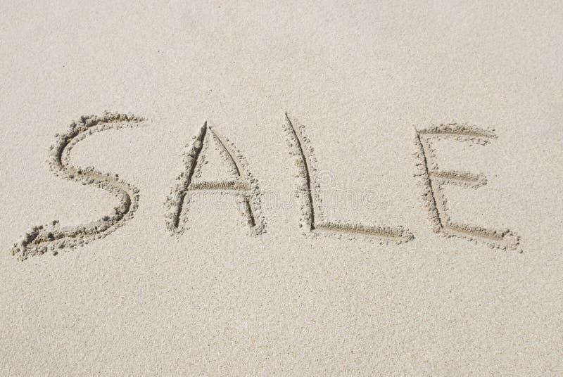 Venda escrita na areia fotos de stock