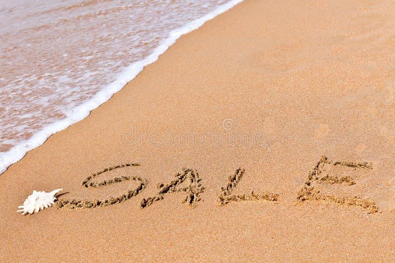 Venda escrita tirada na areia foto de stock royalty free