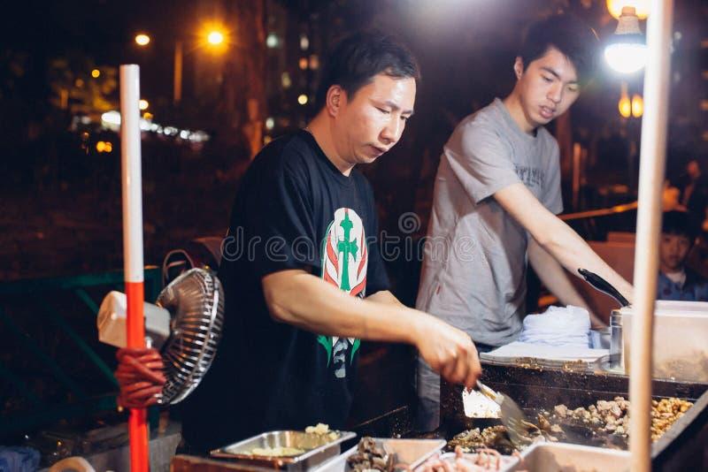 Vendedor ambulante durante día de fiesta del CNY imágenes de archivo libres de regalías