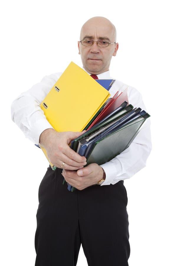Vendedor con las carpetas imagenes de archivo