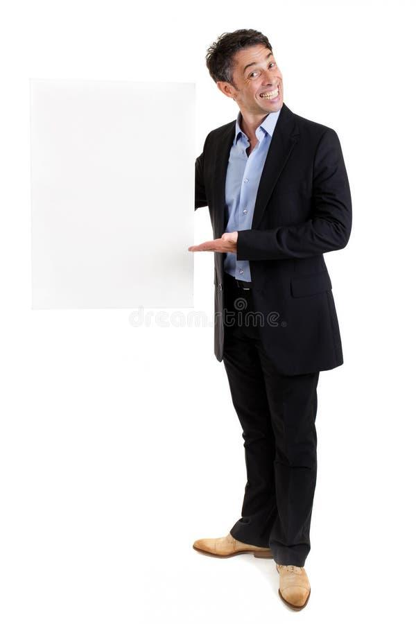 Vendedor con un cartel en blanco foto de archivo libre de regalías