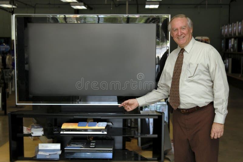 Vendedor de la televisión foto de archivo