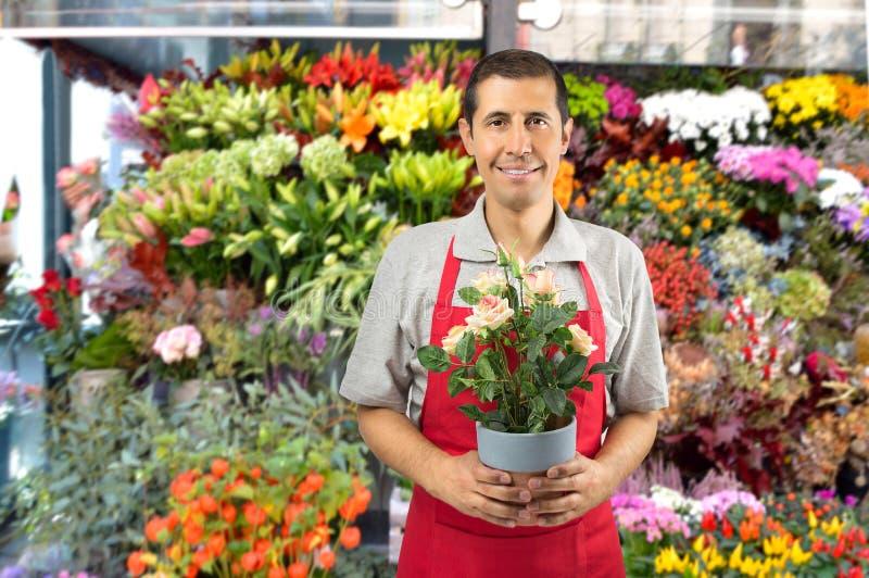 Vendedor do florista pronto para atender fotos de stock