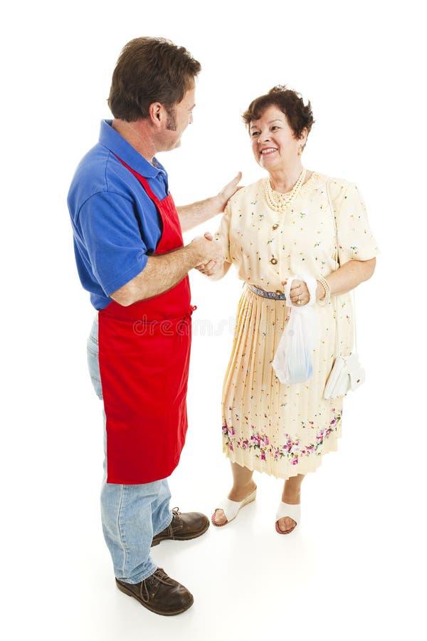 Vendedor e cliente feliz fotos de stock