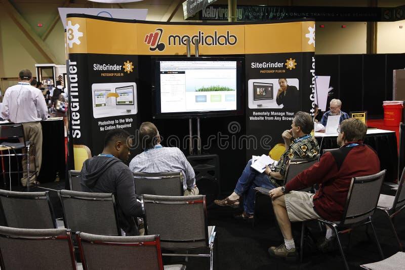 Vendedor en la conferencia y la expo del mundo de Photoshop foto de archivo libre de regalías