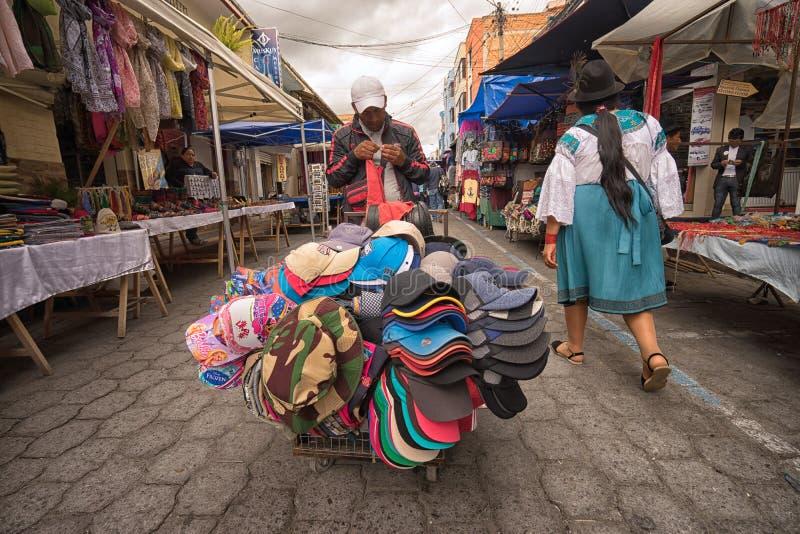 Vendedor móvel que vende chapéus imagens de stock royalty free