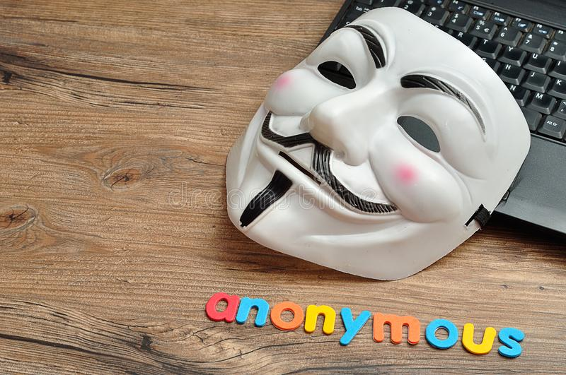 Vendetta mask displayed with anonymous. This mask is a well-know symbol for the group Anon royalty free stock photo