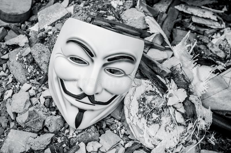 Vendetta mask on the floor of abandoned factory. Paris - France - 19 May 2018 - Vendetta mask on the floor of abandoned factory . This mask is a well-known stock photography