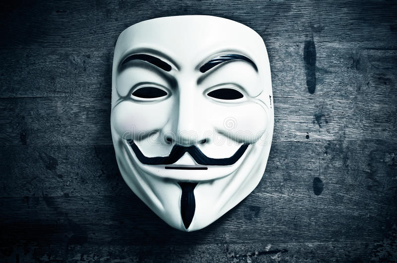 Vendetta mask on wooden background stock image