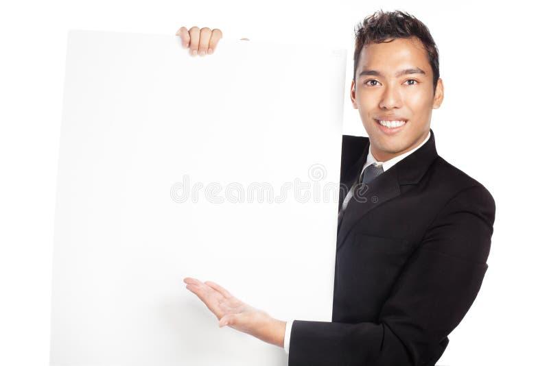 Vendeur beau, homme d'affaires avec la plaquette blanc images libres de droits