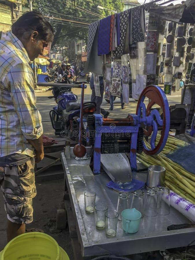 Vendeur de jus de canne de sucre dans Kolkata Inde photographie stock libre de droits