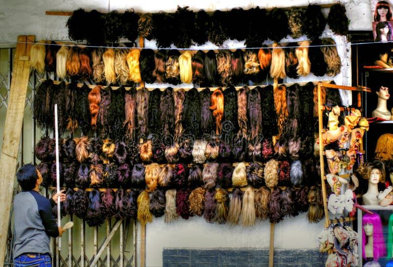 Vendeur de perruque, Indonésie images stock