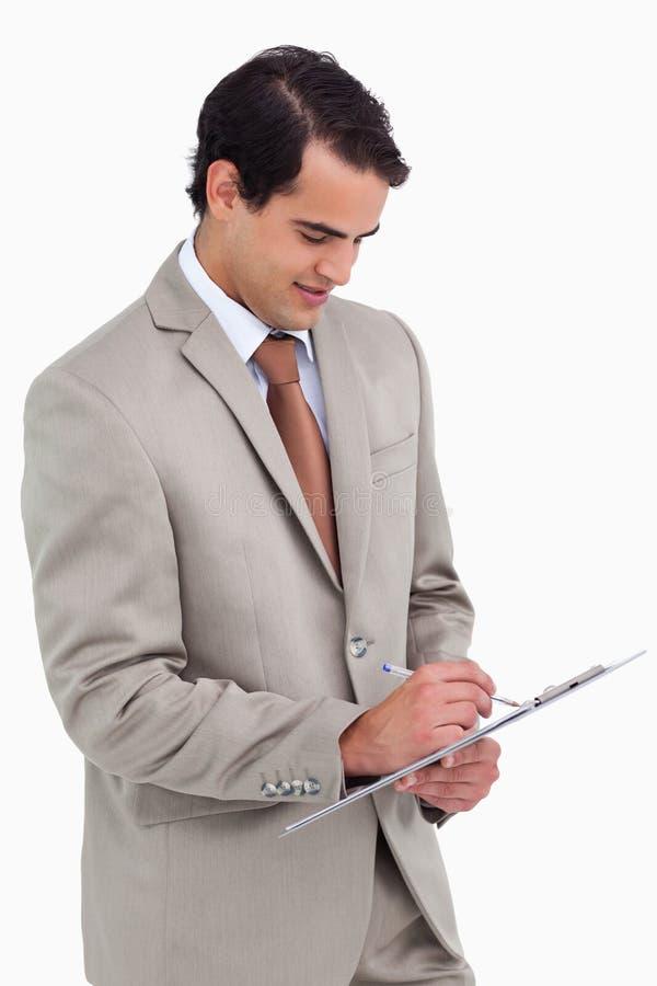 Vendeur prenant des notes images libres de droits