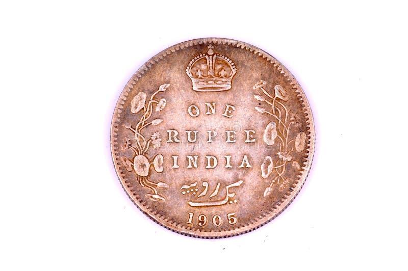 Vendimia una moneda de la rupia imagenes de archivo