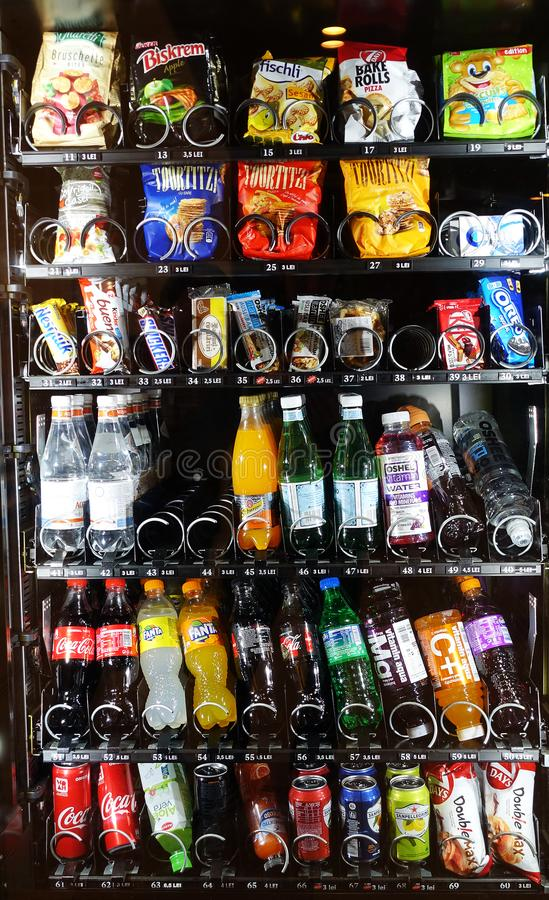TIMISOARA, ROMANIA - JANUARY 16, 2017: Vending machine with wide variety of soft drinks and snacks in Iulius Mall. stock photos
