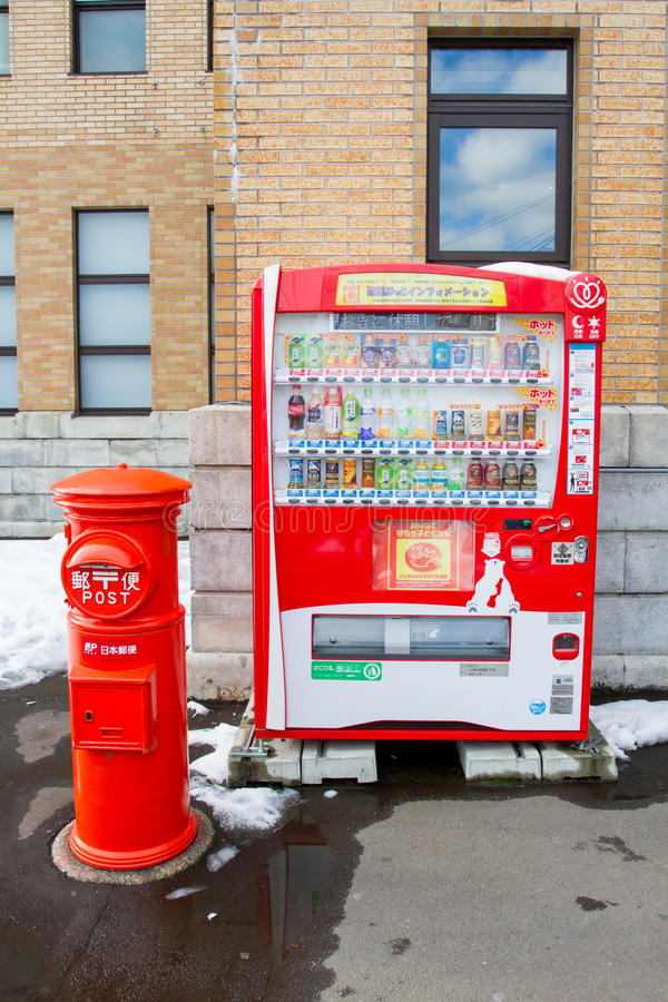 Vending machines and post box in Sapporo, Japan. SAPPORO, JAPAN DEC 9, 2015 : Vending machines and post box in Sapporo on 8 december 2015. Japan has the highest royalty free stock photo