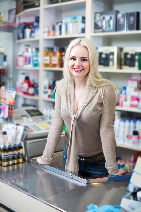 Vendor at counter in store stock images