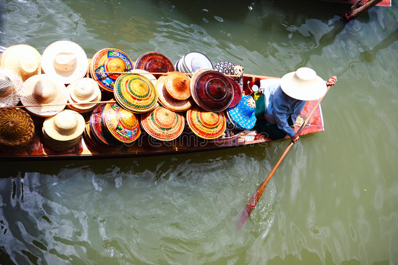 Vendor on floating market in Thailand royalty free stock image
