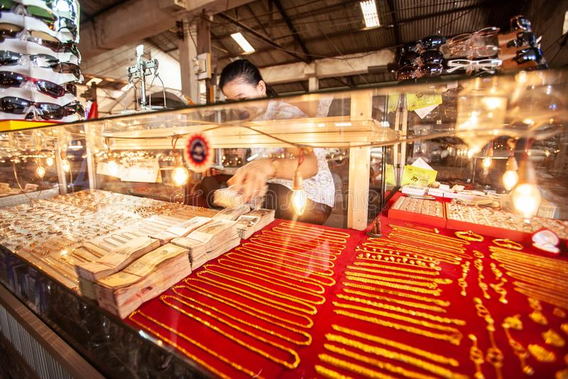 Vendor Khmer woman counting Cambodian Riel at gold shop in the l royalty free stock images