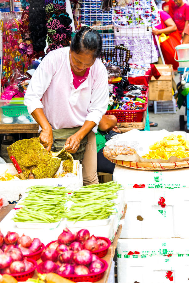 Vendor lady cutting jack fruit royalty free stock images