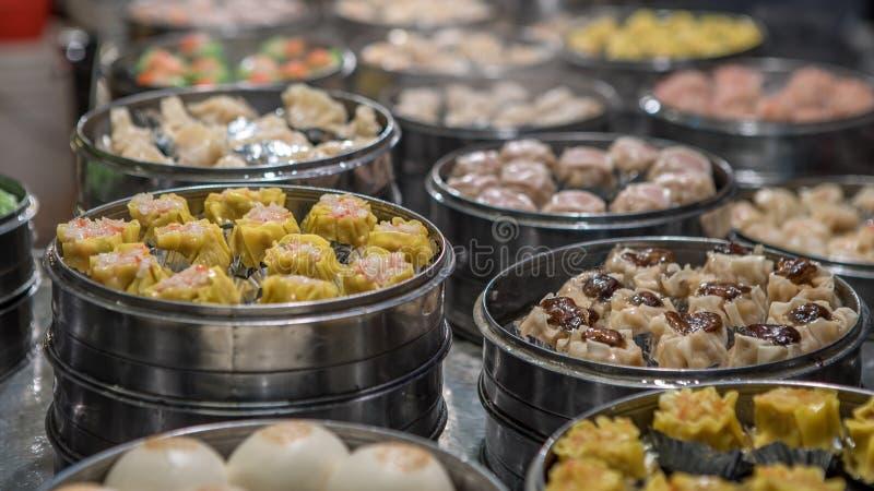 Vendor selling dumpling and shaomai in asian street food market of Taiwan stock photo