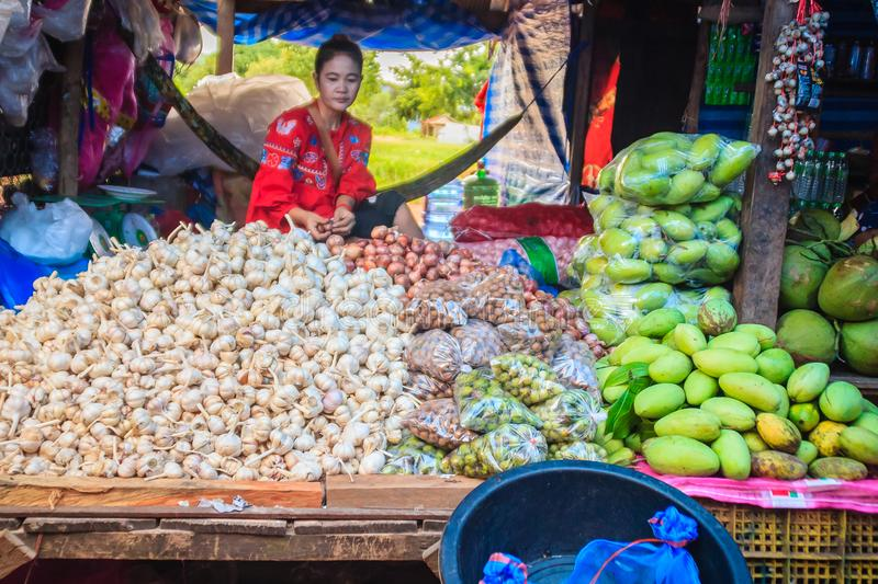 Vendor is selling in flea market at Chong Arn Ma, Thai-Cambodia border crossing (called the An Ses border crossing in Cambodia) to stock image